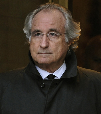 Bernard L. Madoff (R) leaves  US Federal